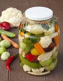 Vegetable pickles. Mixed vegetables preserved in jars Stock Photo