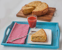Vegetable pie of oat flour and cheese a glass of tomato juice Stock Image