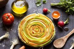 Vegetable pie. Preparing vegetable pie with ingredients stock photo