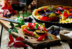 Vegetable pie ratatouille. On a wooden board. Style rustic. selective focus stock images