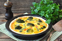 Vegetable pie tart with broccoli, peas, carrot and cheese. Royalty Free Stock Images