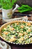 Vegetable pie tart with eggplant, vegetable marrow, soft and hard cheese. selective focus. Royalty Free Stock Photography