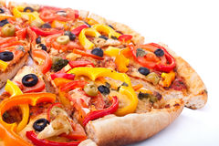 Vegetable pizza cut into slices royalty free stock image