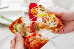 Vegetable pizza on hand. In the morning stock photo
