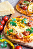 Vegetable pizza and ingredients Royalty Free Stock Image