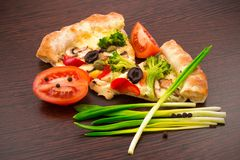 Vegetable pizza on wooden board Stock Photo