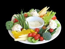 Vegetable platter, isolated, with clipping path. Platter of vegetables in a harmonious arrangement Stock Images