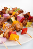 Vegetable and Poultry Grilled Kebabs. Colorful Vegetable and Poultry Grilled Kebabs on Wooden Skewers Close up Stock Images