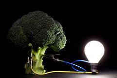 Vegetable powering a light bulb Stock Photo