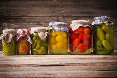 Vegetable preserves. On wooden background Royalty Free Stock Photography