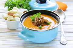 Vegetable pumpkin cream soup with walnuts Royalty Free Stock Photos