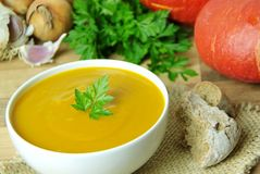 Creamy pumpkin soup. Ingredients for cooking on background. Stock Photos