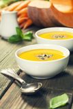 Vegetable or pumpkin soup and ingredients. Warm and comfy autumn concept. stock photos