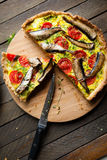 Vegetable quiche with sprats royalty free stock images