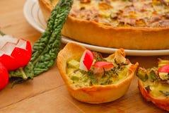 Vegetable quiche tart close-up Stock Photos