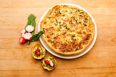 Vegetable quiche tart on plate, countertop Stock Images