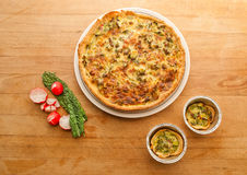 Vegetable quiche tart on plate Royalty Free Stock Images