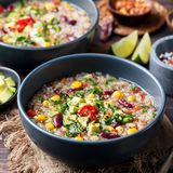 Vegetable quinoa soup stew with avocado corn beans. Vegetable quinoa soup, stew with avocado, corn, beans. South American traditional dish Royalty Free Stock Photo