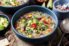 Vegetable quinoa soup stew with avocado corn beans. Vegetable quinoa soup, stew with avocado, corn, beans. South American traditional dish Stock Photography