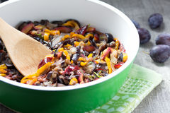 Vegetable Ragout in pan. Ragout of eggplant, plum and sweet pepper in green pan with white ceramic coating Stock Image