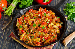 Vegetable ratatouille baked in cast iron frying pan. Homemade preparation recipe healthy diet Royalty Free Stock Image