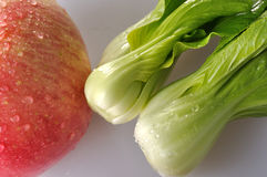 Vegetable and red apple Stock Photos