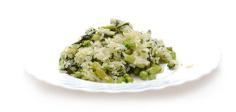 Vegetable risotto with cheese on white plate Stock Image