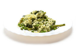 Vegetable risotto with cheese on white plate Stock Photography