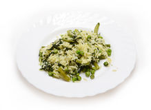 Vegetable risotto with cheese on white plate Royalty Free Stock Photos