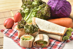 Vegetable Roll on wooden background,Weight loss diet food. Royalty Free Stock Images
