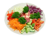 Vegetable salad. From a cabbage, tomato, cucumbers, carrot, parsley (Clipping Path royalty free stock photo