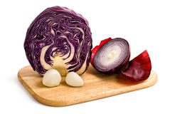 Vegetable salad. Half of cabbage, two cloves garlic and half of red onion isolated on a white background Stock Photos