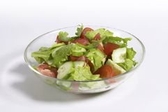 Vegetable salad. Vegetarian diet. Summery salad: lettuce, tomato and cucumber in the glassy bowl stock photo
