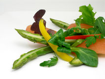 Vegetable salad. Salad of vegetables and asparagus in decoration style royalty free stock photos