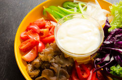 Vegetable salad. In orange bowl Royalty Free Stock Photography