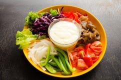 Vegetable salad. In orange bowl Royalty Free Stock Photo