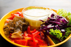 Vegetable salad. In orange bowl Stock Image