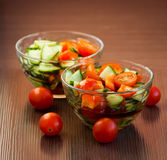 Vegetable Salad. A plate of salad with tomato and cucumbers Royalty Free Stock Photography
