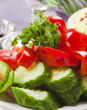 Vegetable salad. Cucumber pepper and parsley on holiday table Stock Photography