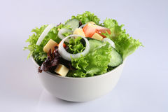 Vegetable salad. Salad with vegetable, onion ring, cucumber and cheese stock photography