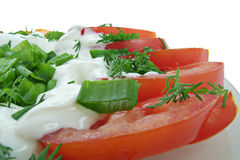Vegetable salad. Of tomatoes, sweet peppers, spring onions, dill and sour cream Stock Photo