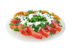 Vegetable salad. Of tomatoes, sweet peppers, spring onions, dill and sour cream Stock Image