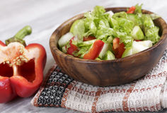 Vegetable salad with apple. Salad in a wooden bowl, fresh vegetables with apple Royalty Free Stock Photography
