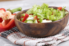 Vegetable salad with apple. Salad in a wooden bowl, fresh vegetables with apple Royalty Free Stock Photos