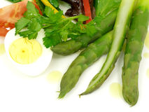 Vegetable salad,asparagus and boiled egg. Salad of vegetables and asparagus with boiled egg stock images