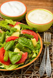 Vegetable salad with asparagus, young potatoes, lettuce, tomatoes and spinach, served with garlic sauce. Stock Photo