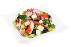 Vegetable salad with avocado, surimi and fetus Stock Images