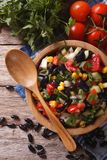 Vegetable salad with black beans close-up vertical top view Royalty Free Stock Photos