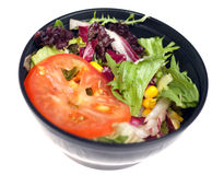 Vegetable salad in black bowl Stock Photos