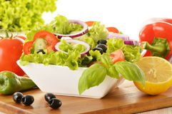 Vegetable salad bowl on kitchen table Stock Photo